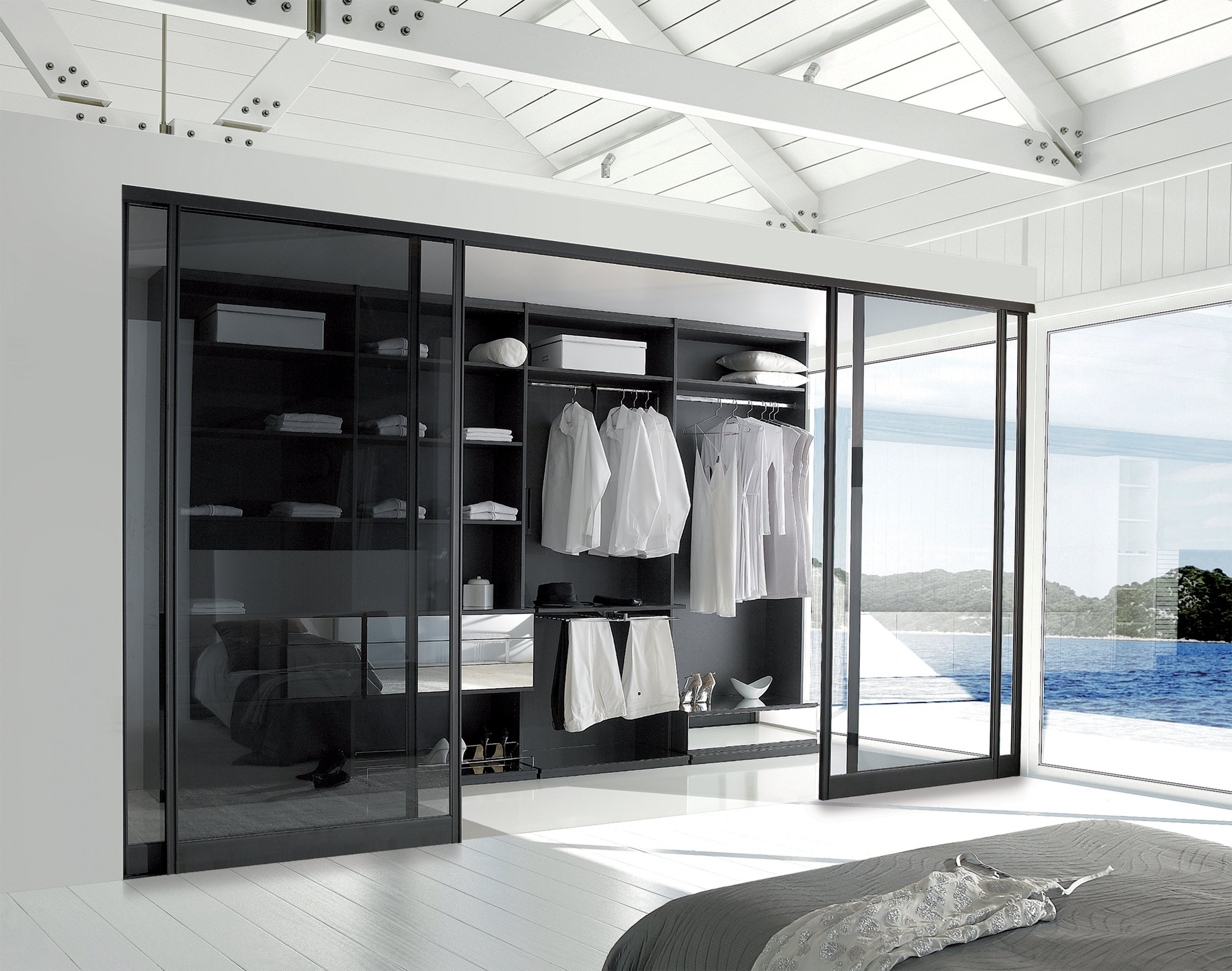 empty white room with large windows and scenic view.